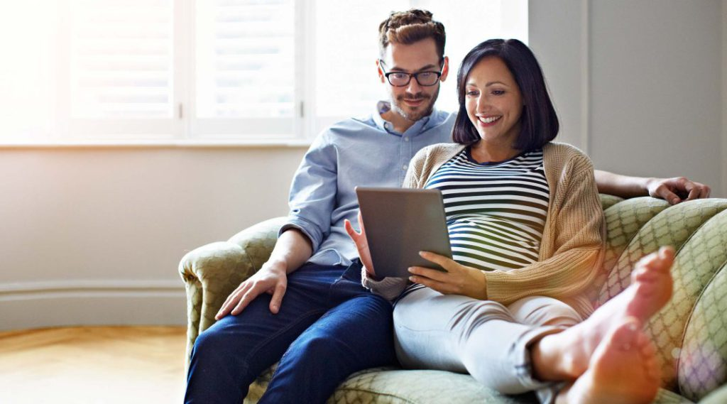Two people browsing homeowner loans