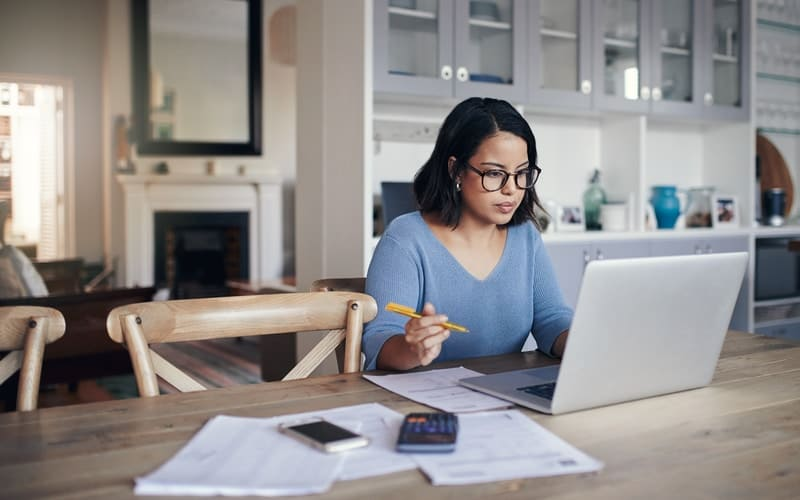Woman looking through her credit score and report