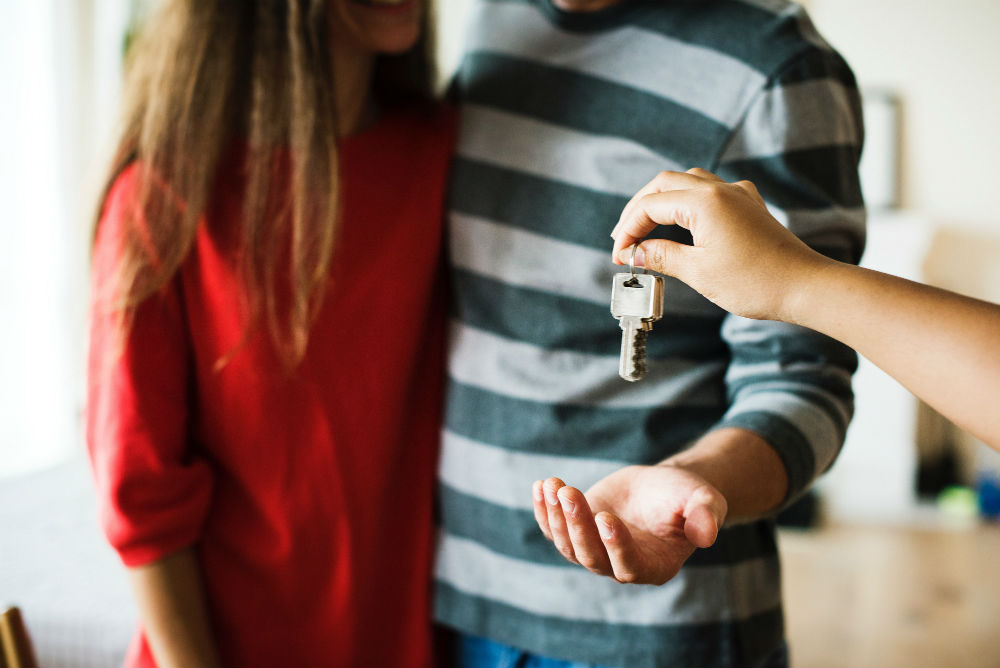 People receiving keys to new home