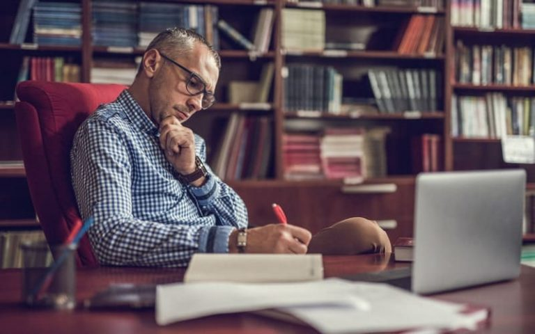 Man in a study understanding financial jargon