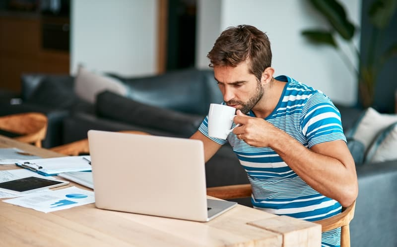 Man on laptop looking at his early repayment charge
