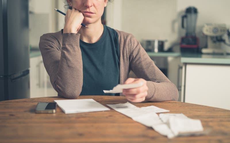 Person managing money through debt consolidation