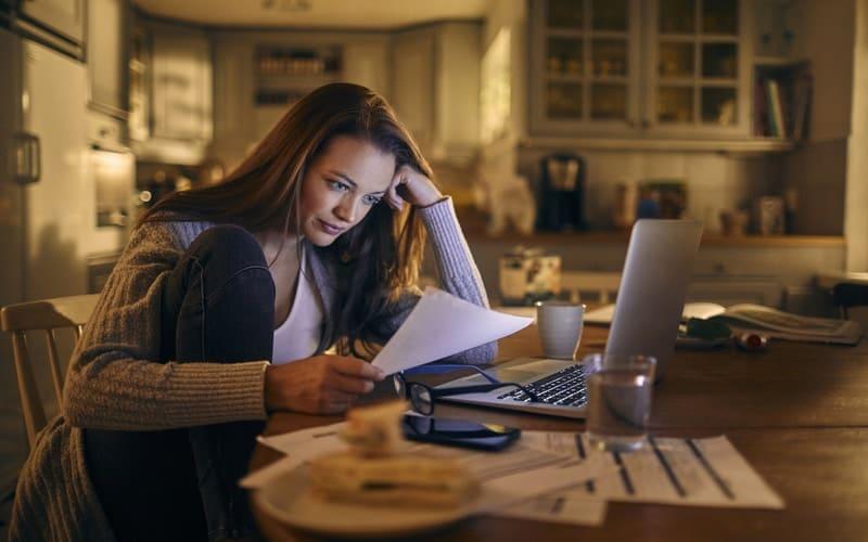 Woman reducing debts into smaller monthly repayments